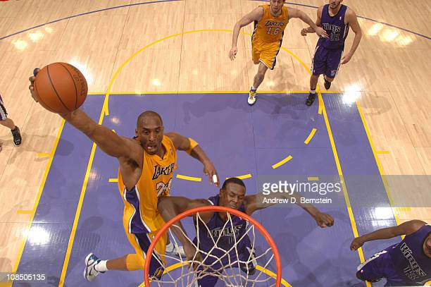 Kobe Bryant of the Los Angeles Lakers rises for a dunk against Samuel Dalembert of the Sacramento Kings at Staples Center on January 28 2011 in Los...