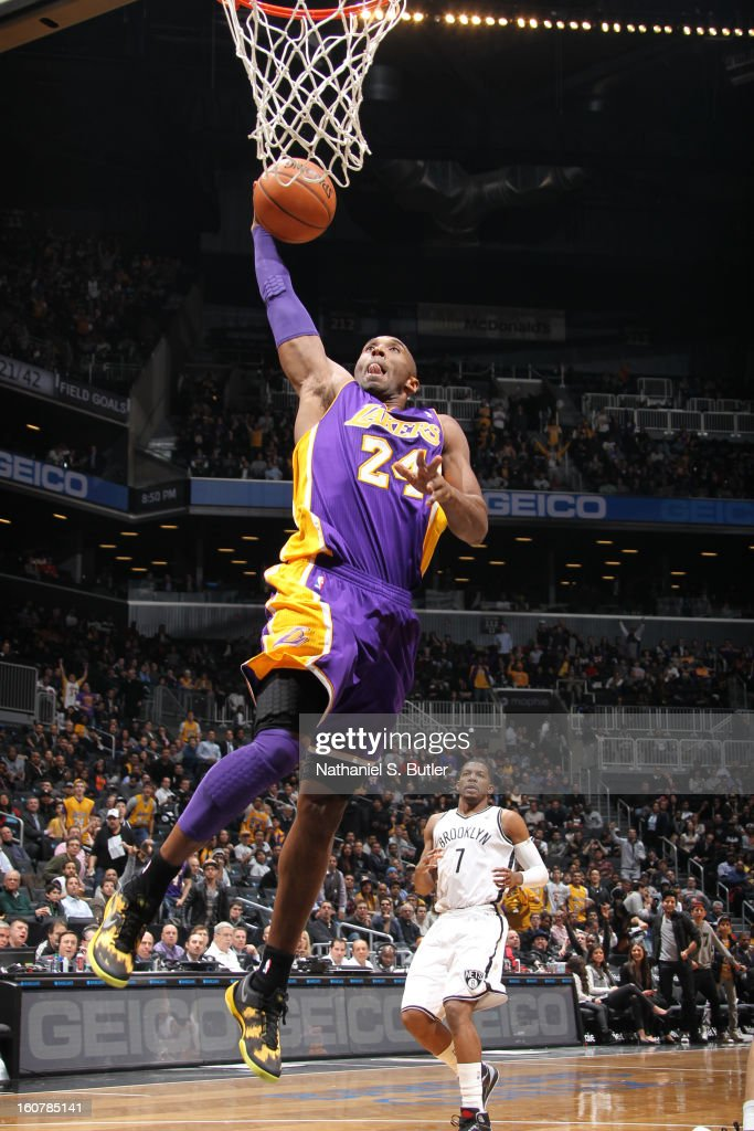 Kobe Bryant #24 of the Los Angeles Lakers rises for a dunk against the Brooklyn Nets on February 5, 2013 at the Barclays Center in the Brooklyn borough of New York City.