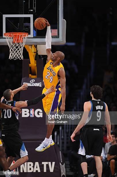 Kobe Bryant of the Los Angeles Lakers rises for a dunk against the Minnesota Timberwolves at Staples Center on February 28 2013 in Los Angeles...