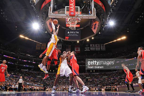 Kobe Bryant of the Los Angeles Lakers rises for a dunk against the Atlanta Hawks at Staples Center on March 3 2013 in Los Angeles California NOTE TO...
