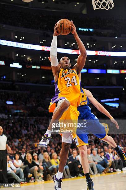 Kobe Bryant of the Los Angeles Lakers rises for a dunk against the Golden State Warriors at Staples Center on April 12 2013 in Los Angeles California...
