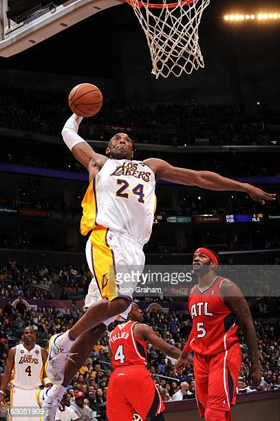 Kobe Bryant of the Los Angeles Lakers rises for a dunk ahead if Josh Smith of the Atlanta Hawks at Staples Center on March 3, 2013 in Los Angeles,...