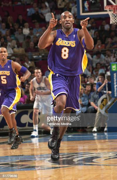 Kobe Bryant of the Los Angeles Lakers runs upcourt and points while facing the Orlando Magic during a game at TD Waterhouse Centre on November 12...