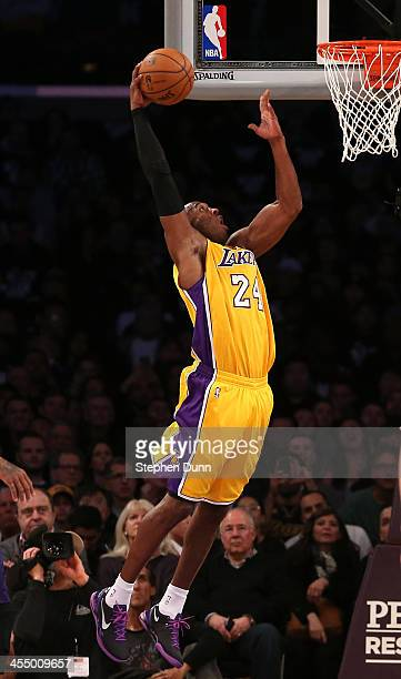 Kobe Bryant of the Los Angeles Lakers scores a basket against the Phoenix Suns at Staples Center on December 10 2013 in Los Angeles California NOTE...