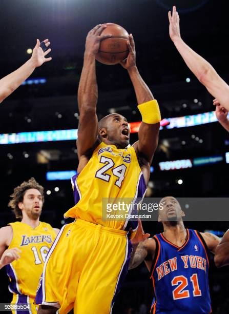 Kobe Bryant of the Los Angeles Lakers scores a basket against Wilson Chandler of the New York Knicks during the first quarter of the NBA game at...