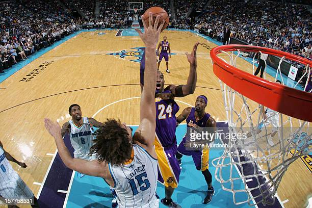 Kobe Bryant of the Los Angeles Lakers scores his 30000th point during the game between the New Orleans Hornets and the Los Angeles Lakers on December...