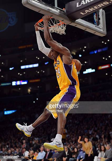 Kobe Bryant of the Los Angeles Lakers scores on a reverse dunk during the game against the Minnesota Timberwolves at Staples Center on February 28...