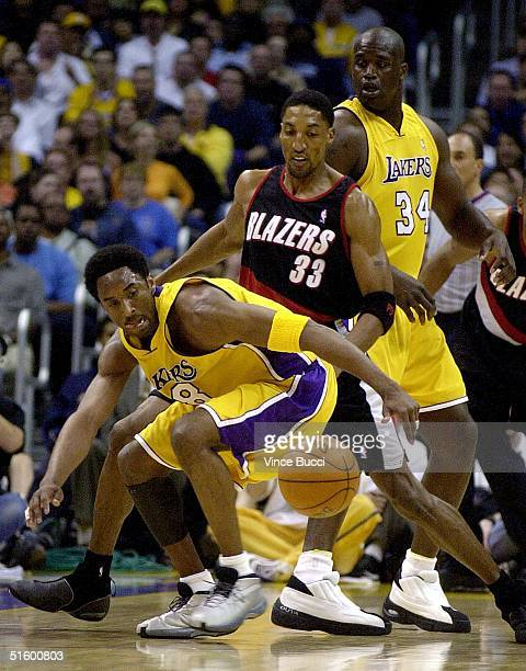 Kobe Bryant of the Los Angeles Lakers scrambles for a ball against Scottie Pippen of the Portland Trail Blazers during Game Two of the NBA Western...