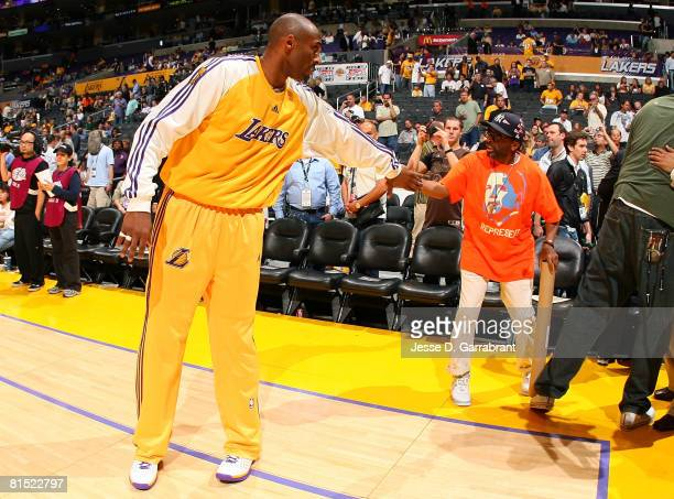 Kobe Bryant of the Los Angeles Lakers shakes hands with director Spike Lee before taking on the Boston Celtics in Game Three of the 2008 NBA Finals...