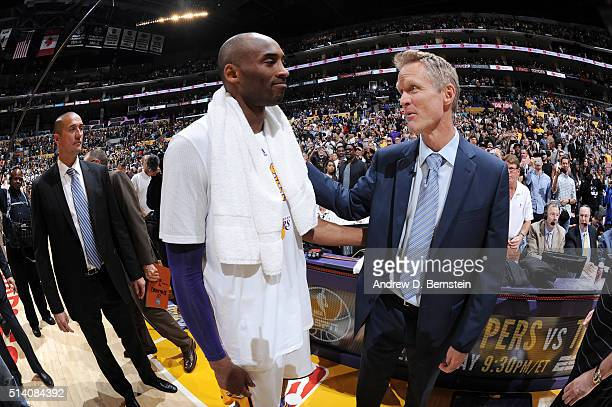 Kobe Bryant of the Los Angeles Lakers shakes hands with head coach Steve Kerr of the Golden State Warriors after the game on March 6 2016 at STAPLES...