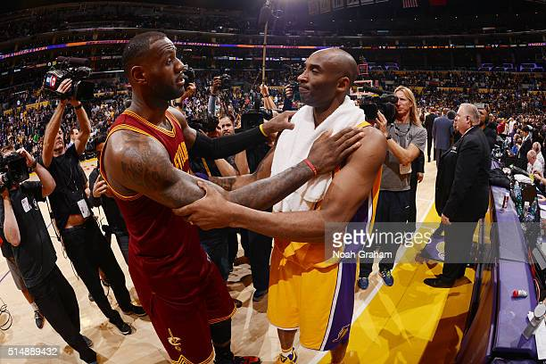 Kobe Bryant of the Los Angeles Lakers shakes hands with LeBron James of the Cleveland Cavaliers after the game at STAPLES Center on March 10 2016 in...