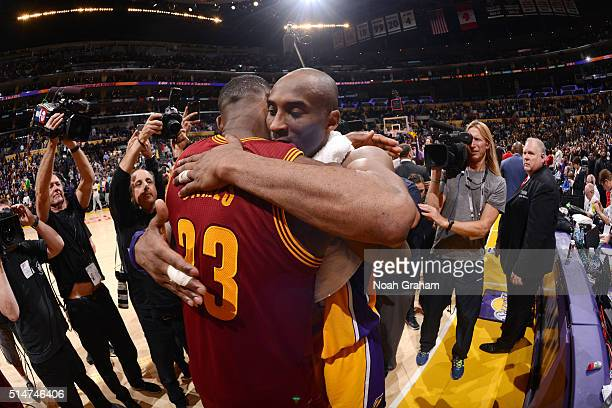Kobe Bryant of the Los Angeles Lakers shares a hug with LeBron James of the Cleveland Cavaliers after the game on March 10 2016 at STAPLES Center in...