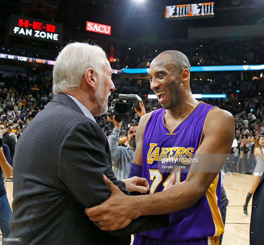Kobe Bryant #24 of the Los Angeles Lakers shares a light moment with San Antonio Spurs head coach Gregg Popovich at AT&T Center on February 6, 2016 in San Antonio, Texas.