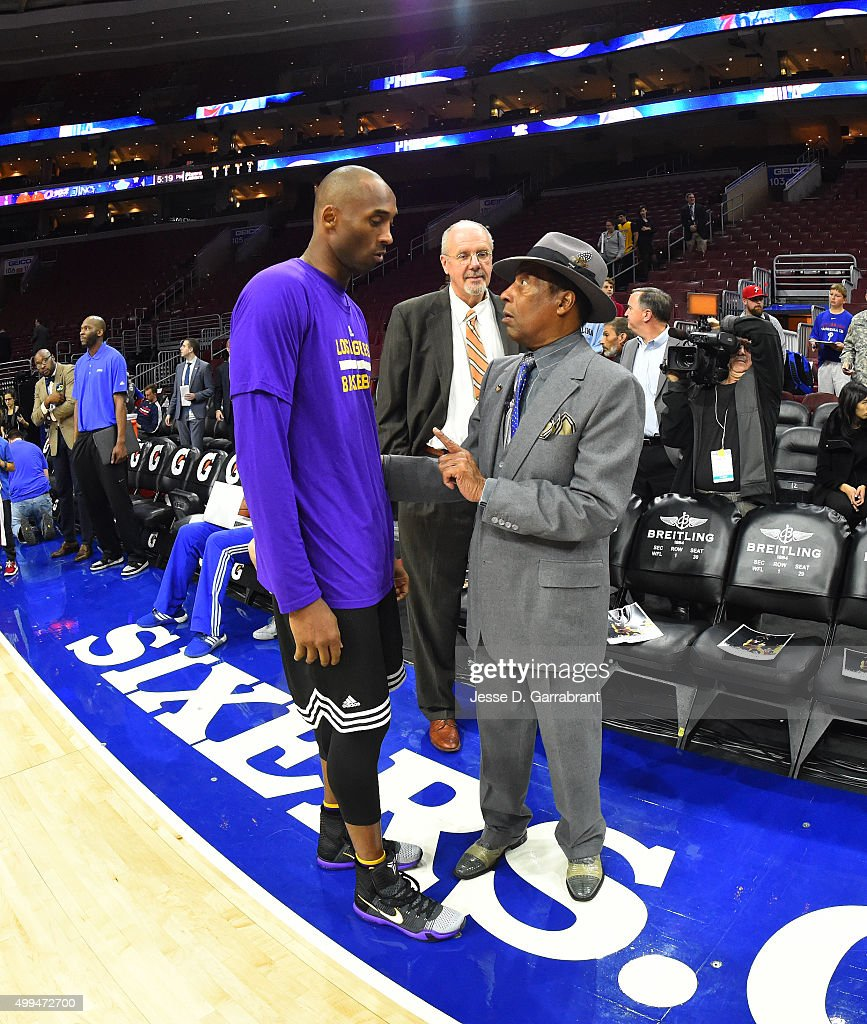 Kobe Bryant #24 of the Los Angeles Lakers shares a moment prior to the game against the Philadelphia 76ers at Wells Fargo Center on December 1, 2015 in Philadelphia, Pennsylvania