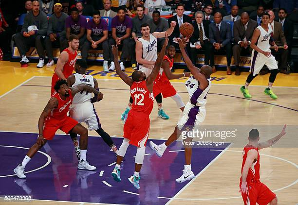 Kobe Bryant of the Los Angeles Lakers shoots a fade away jump shot against Luc Richard Mbah a Moute of the Los Angeles Clippers in the first half at...