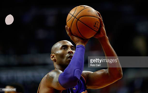 Kobe Bryant of the Los Angeles Lakers shoots a free throw against the Washington Wizards at Verizon Center on December 2 2015 in Washington DC NOTE...
