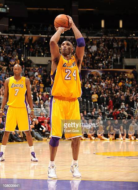 Kobe Bryant of the Los Angeles Lakers shoots a free throw during a game against the Philadelphia 76ers at the Staples Center on December 31 2010 in...