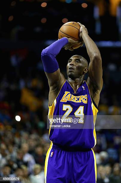 Kobe Bryant of the Los Angeles Lakers shoots a free throw late in the fourth quarter against the Charlotte Bobcats to give his team the lead at Time...