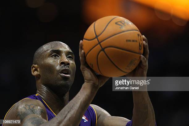 Kobe Bryant of the Los Angeles Lakers shoots a freethrow against the Milwaukee Bucks at the Bradley Center on November 16 2010 in Milwaukee Wisconsin...