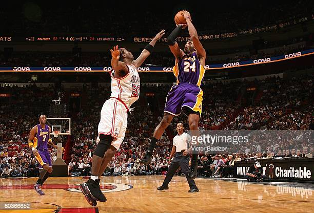 Kobe Bryant of the Los Angeles Lakers shoots a jump shot over Ricky Davis of the Miami Heat during the game at the American Airlines Arena on...