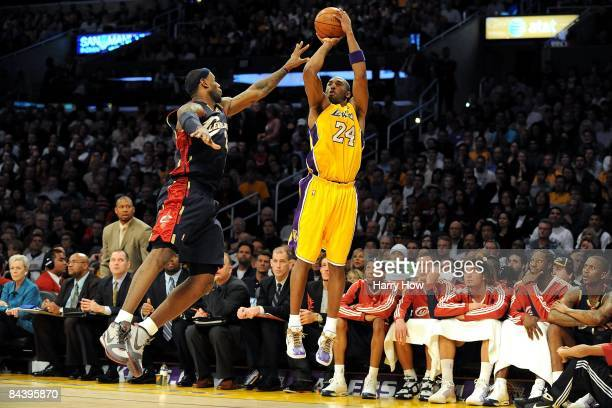 Kobe Bryant of the Los Angeles Lakers shoots a jumper against LeBron James of the Cleveland Cavaliers during the game at Staples Center on January 19...