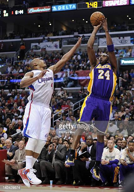 Kobe Bryant of the Los Angeles Lakers shoots a jumper against Randy Foye of the Los Angeles Clippers during the first halfat Staples Center on April...
