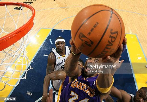 Kobe Bryant of the Los Angeles Lakers shoots a layup against Zach Randolph of the Memphis Grizzlies on February 7 2011 at FedExForum in Memphis...