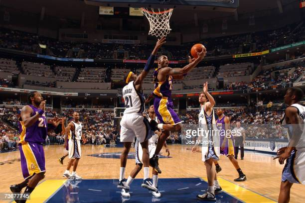 Kobe Bryant of the Los Angeles Lakers shoots a layup around Hakim Warrick of the Memphis Grizzlies on March 22 2007 at FedExForum in Memphis...