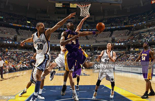 Kobe Bryant of the Los Angeles Lakers shoots a layup past Dahntay Jones of the Memphis Grizzlies on March 22, 2007 at FedExForum in Memphis,...