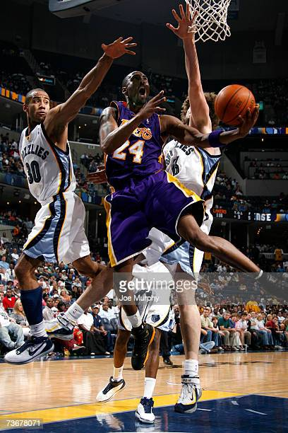 Kobe Bryant of the Los Angeles Lakers shoots a layup past Dahntay Jones of the Memphis Grizzlies on March 22 2007 at FedExForum in Memphis Tennessee...