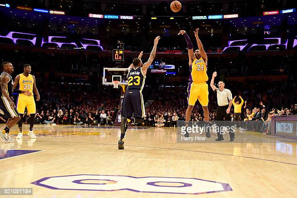 Kobe Bryant of the Los Angeles Lakers shoots a three pointer over Chris Johnson of the Utah Jazz in the second half at Staples Center on April 13,...
