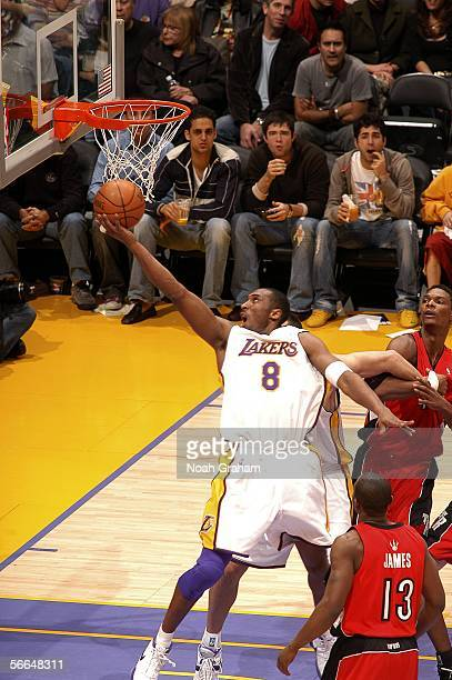 Kobe Bryant of the Los Angeles Lakers shoots against Chris Bosh and Mike James of the Toronto Raptors on January 22 2006 at Staples Center in Los...