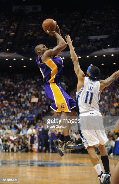 Kobe Bryant of the Los Angeles Lakers shoots against Courtney Lee of the Orlando Magic during Game Five of the 2009 NBA Finals at Amway Arena on June...
