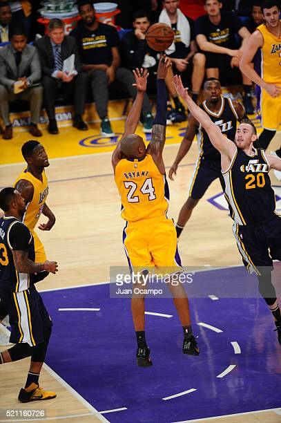 Kobe Bryant of the Los Angeles Lakers shoots against Gordon Hayward of the Utah Jazz at STAPLES Center on April 13 2016 in Los Angeles California...
