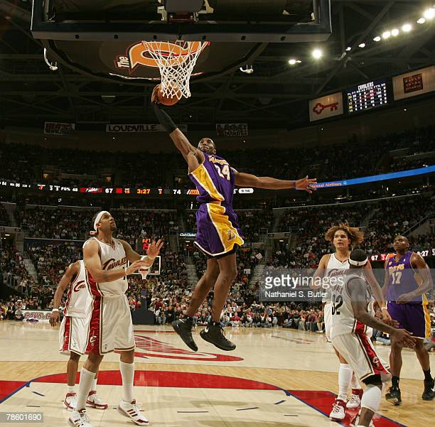 Kobe Bryant of the Los Angeles Lakers shoots against Ira Newble of the Cleveland Cavaliers at the Quicken Loans Arena December 20, 2007 in Cleveland,...