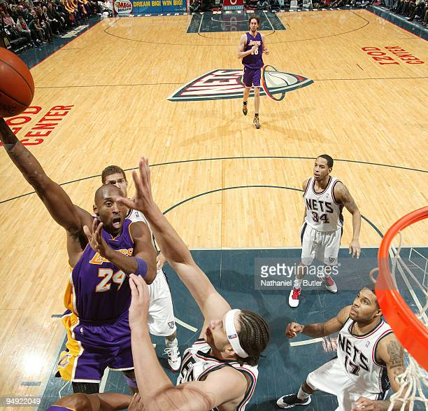 Kobe Bryant of the Los Angeles Lakers shoots against Josh Boone of the New Jersey Nets on December 19 2009 at the IZOD Center in East Rutherford New...