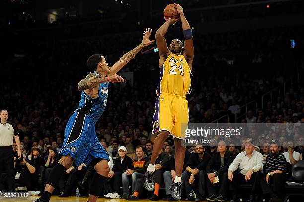 Kobe Bryant of the Los Angeles Lakers shoots against Matt Barnes of the Orlando Magic in the first quarter during the game on January 18 2010 at...