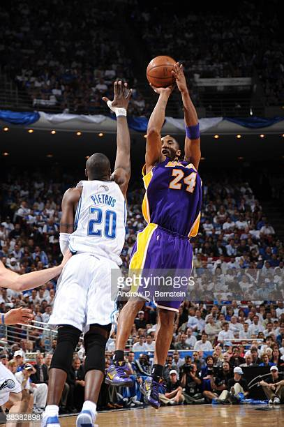 Kobe Bryant of the Los Angeles Lakers shoots against Mickael Pietrus of the Orlando Magic during Game Three of the 2009 NBA Finals at Amway Arena on...