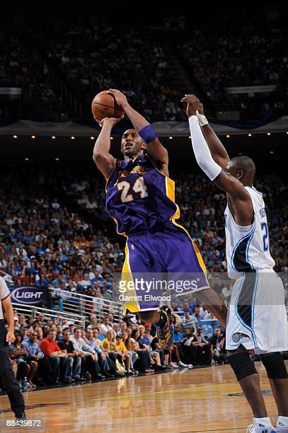 Kobe Bryant of the Los Angeles Lakers shoots against Mickael Pietrus of the Orlando Magic during Game Four of the 2009 NBA Finals at Amway Arena on...