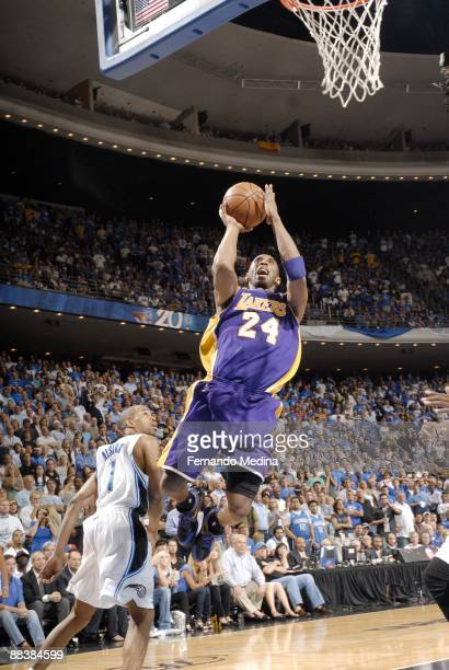 Kobe Bryant of the Los Angeles Lakers shoots against Rafer Alston of the Orlando Magic during Game Three of the 2009 NBA Finals at Amway Arena on...