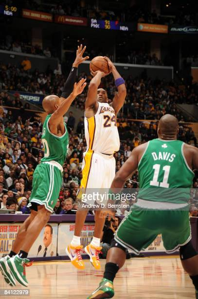 Kobe Bryant of the Los Angeles Lakers shoots against Ray Allen and Glen Davis of the Boston Celtics at Staples Center on December 25 2008 in Los...