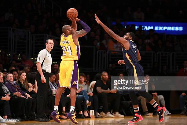 Kobe Bryant of the Los Angeles Lakers shoots an outside jump shot against Tyreke Evans of the New Orleans Pelicans during the NBA game at Staples...