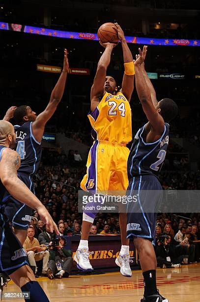 Kobe Bryant of the Los Angeles Lakers shoots between CJ Miles and Paul Millsap of the Utah Jazz at Staples Center on April 2 2010 in Los Angeles...