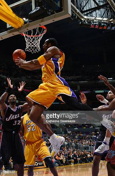 Kobe Bryant of the Los Angeles Lakers shoots during a game against the Utah Jazz at Staples Center on December 8, 2002 in Los Angeles, California....