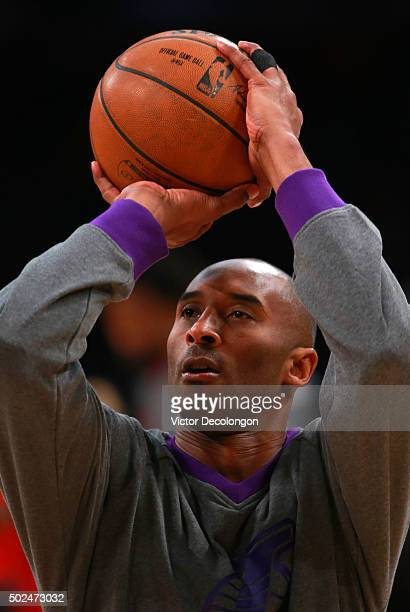 Kobe Bryant of the Los Angeles Lakers shoots during warmup prior to the NBA game against the Los Angeles Clippers at Staples Center on December 25...