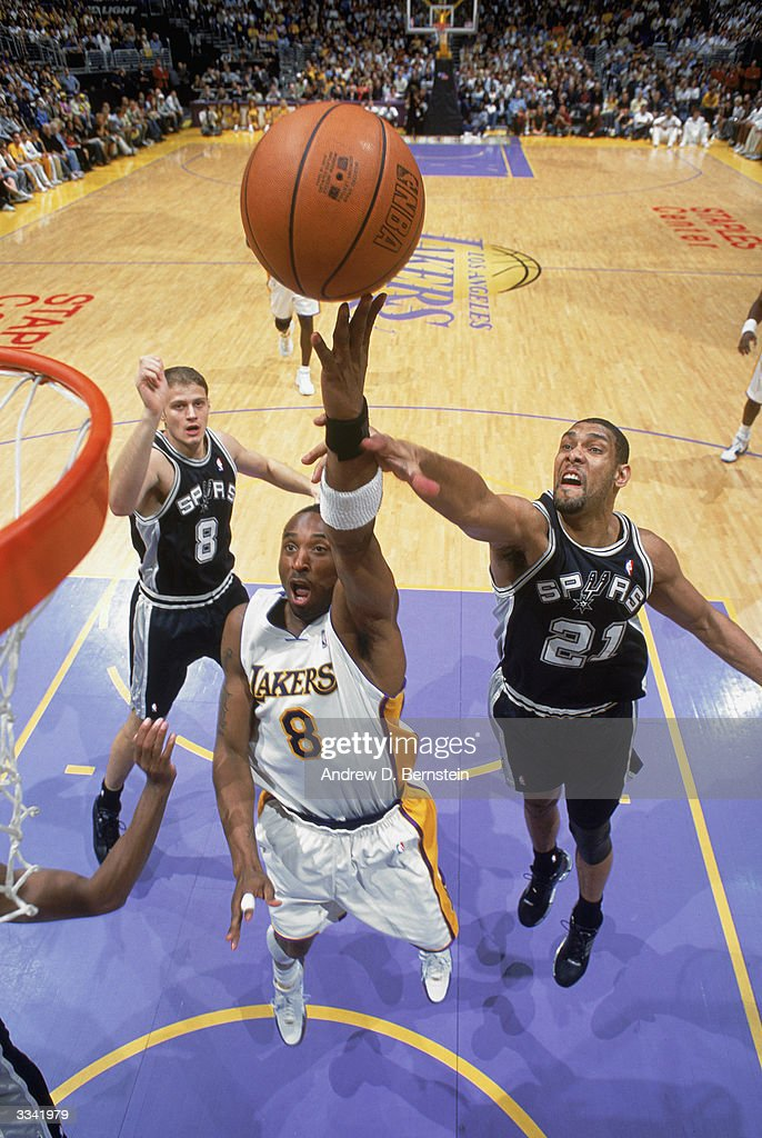 96a20d56a Kobe Bryant of the Los Angeles Lakers shoots in front of Tim Duncan ...