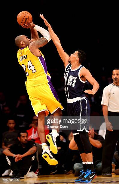 Kobe Bryant of the Los Angeles Lakers shoots over Andre Roberson of the Oklahoma City Thunder at Staples Center on December 19 2014 in Los Angeles...