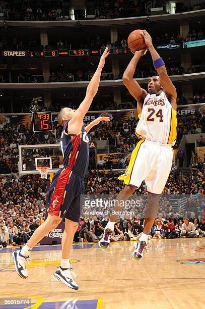 Kobe Bryant of the Los Angeles Lakers shoots over Anthony Parker of the Cleveland Cavaliers at Staples Center on December 25 2009 in Los Angeles...