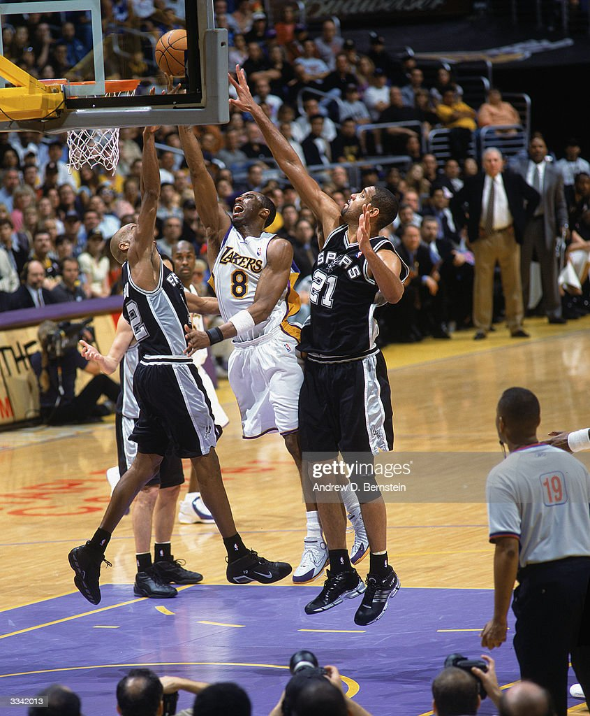 77807826e Spurs v Lakers. LOS ANGELES - APRIL 4  Kobe Bryant  8 of the Los Angeles  Lakers shoots over both Tim Duncan ...