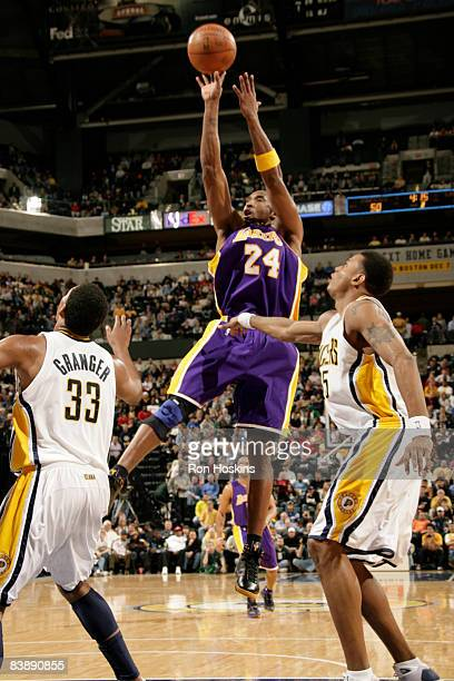 Kobe Bryant of the Los Angeles Lakers shoots over Brandon Rush and Danny Granger of the Indiana Pacers at Conseco Fieldhouse on December 2 2008 in...